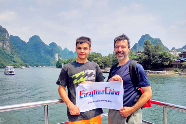 Family Taking Li River Cruise from Guilin to Yangshuo