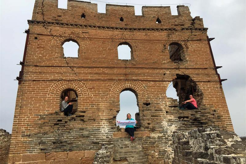 Three women hike Jinshanling Great Wall of China