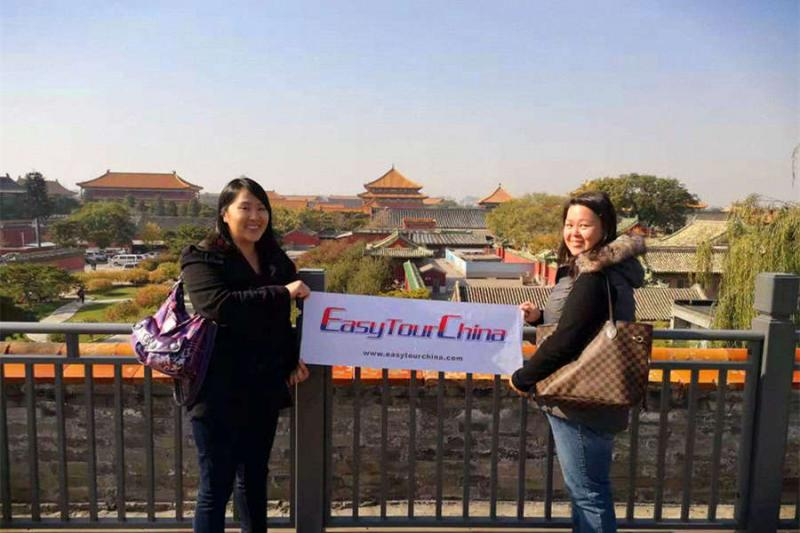 Two female travelers visit Forbidden City