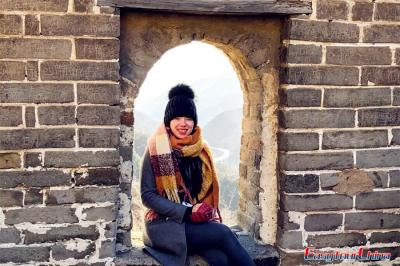 Woman visiting Beijing Great Wall Mutianyu section in winter
