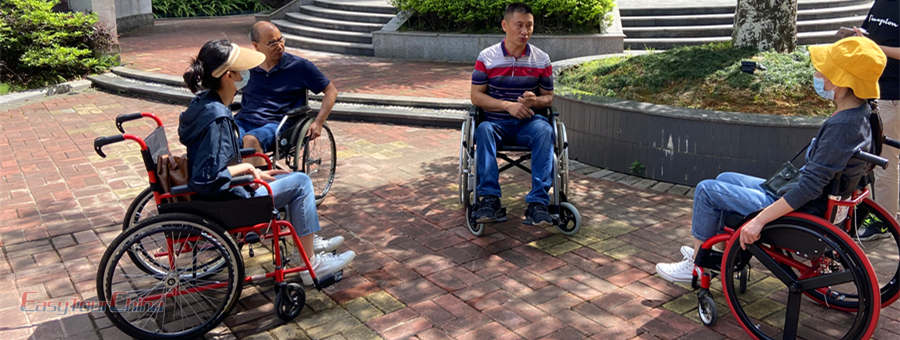 Easy Tour China team learn to use wheelchair