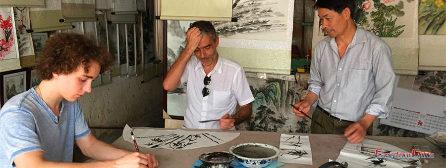 Paris father and son living in Shanghai take a painting class in Yangshuo