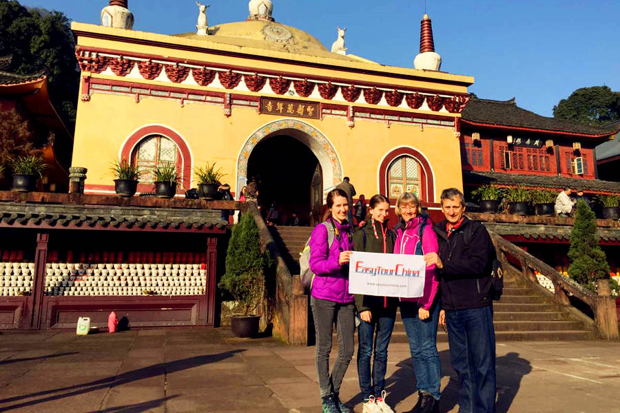 A family from USA visit temple at Mount Emei