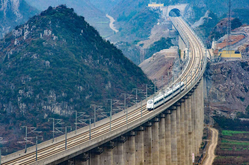 Take a fantastic train journey in China - train traverse mountains