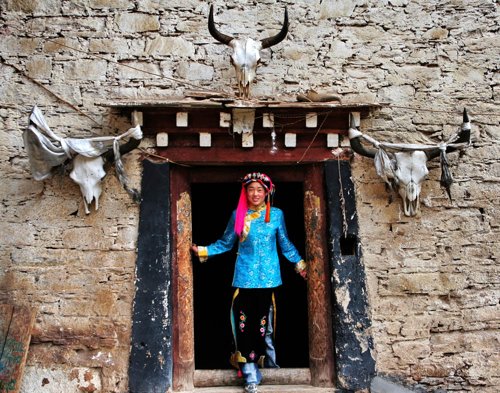Tibetan Girl Standing front of Her Door