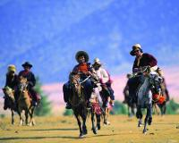 Tibetans Riding on horses in Daocheng Yading