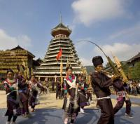 Travel Photos of Dong Minority People Dancing in Front of Drum-tower