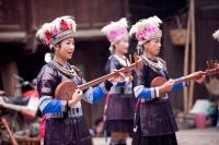 Travel Photos of Dong Minority Playing Instrument