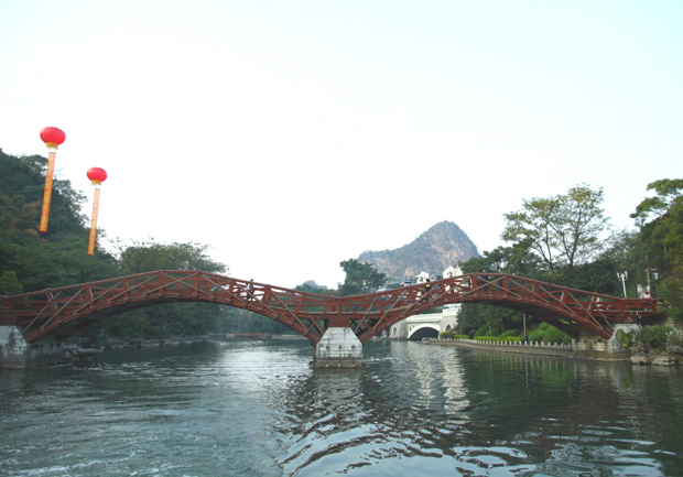 Downtown Waterway System (Two Rivers and Four Lakes) Red Bridge Over Lake