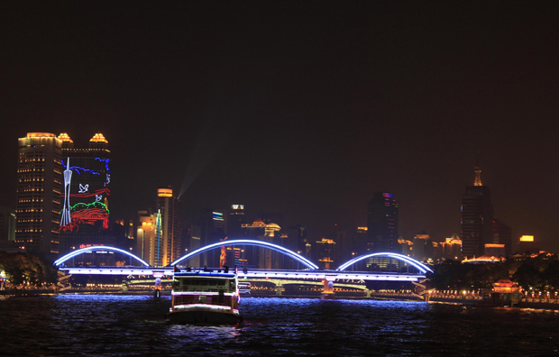 Evening cruise on Pearl River Architecture Covered in Colorful Lights