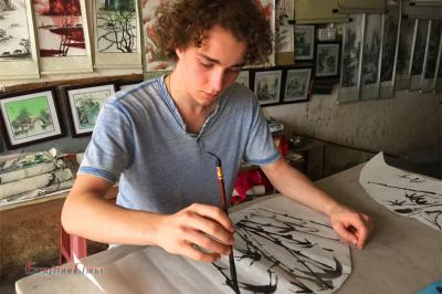 French boy learn Chinese Painting in Yangshuo