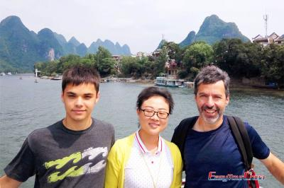 American Father & Son on Li River Cruise Boat in 2017