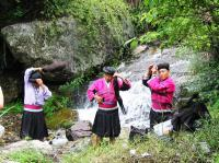 Red Yao Women With Long Dark Hair