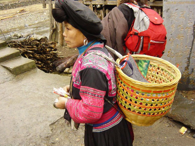 Red Yao Woman Carried a Bamboo Basket on His Back
