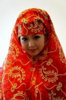 Travel Photos of Hui Minority Lady Wrapped with Red Mantilla