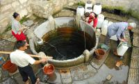 jianshui ancient town, fetch water
