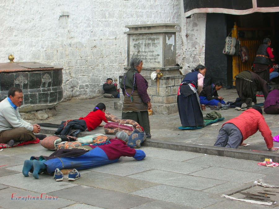 Local Tibetan people pray in front of Jokhang Temple in Lhasa