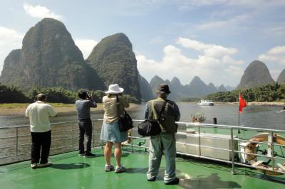 Guests Taking Photos on A Li River Cruise Ship