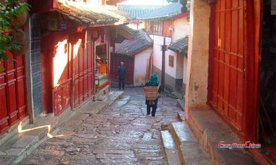 Lijiang Naxi People Carrying Bamboo Basket