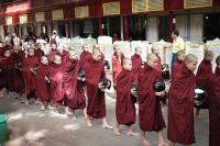Monks waiting in line for alms
