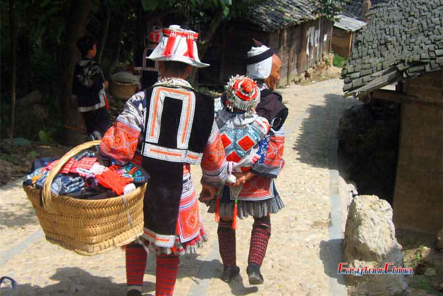 See gejia ladies dressed in colorful traditional costumes