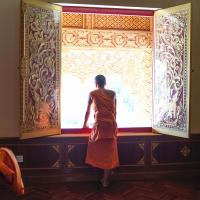 A Monk inside the Mengle Great Buddha Temple - by Felice Simon