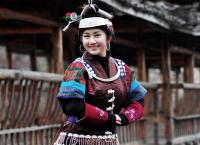Miao Girl dressed in Traditional Clothes