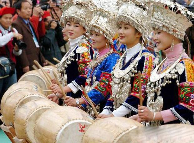 Travel Photos of Miao Minority Women Playing Drums