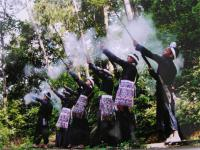 Travel Photos of Miao Minority Men Firing Gun Barrel