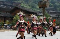 Travel Photos of Miao Minority Women Dancing in Short Skirts