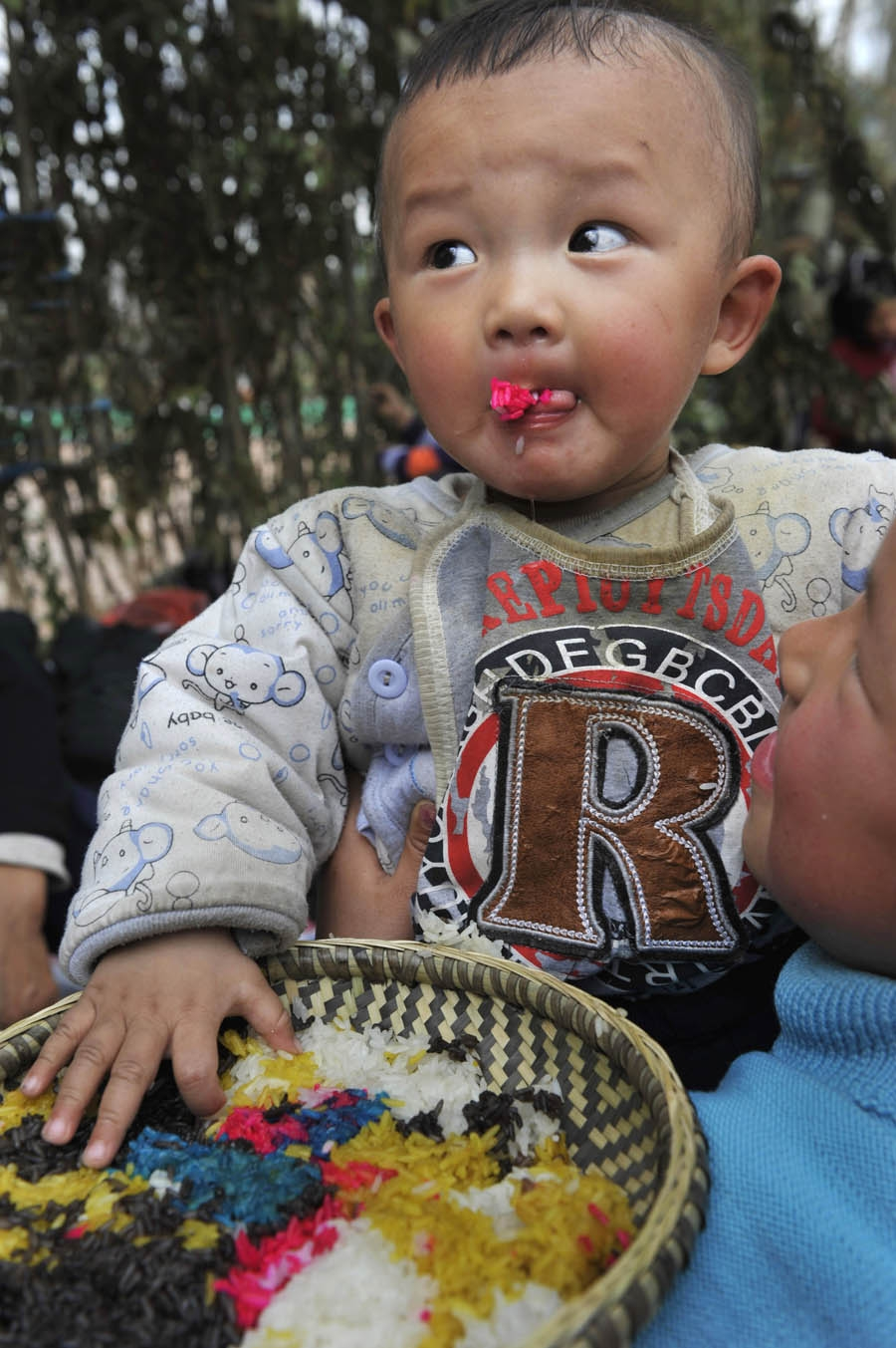 Miao Child Eating Colorful Rice