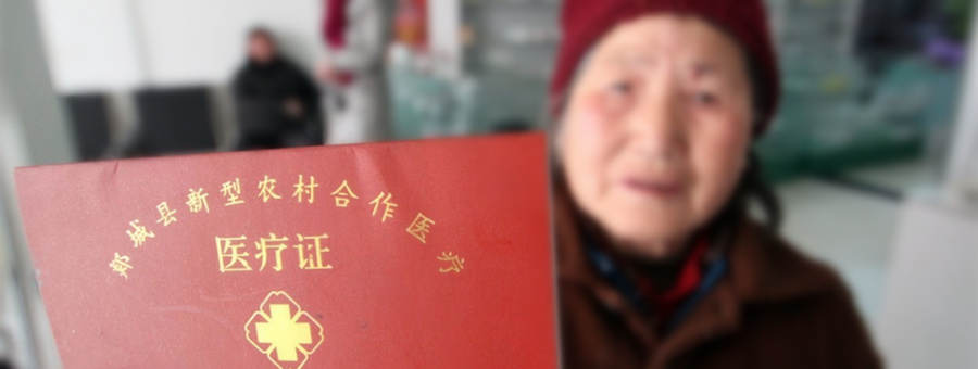 An old lady apply for New Rural Cooperative Medical card in China