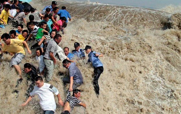 People knocked down by Qiantang River Tide (Wave)
