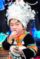 The Miao child in traditional clothes