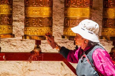 Tibetan Old Lady Spinning Prayer Wheels