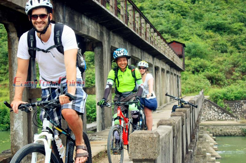 Robert and Dutch Customers Cycling to Guilin Countryside in 2015