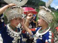 miao ladies and silver ornaments