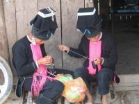 Travel Photos of Yao Minority Women Sewing