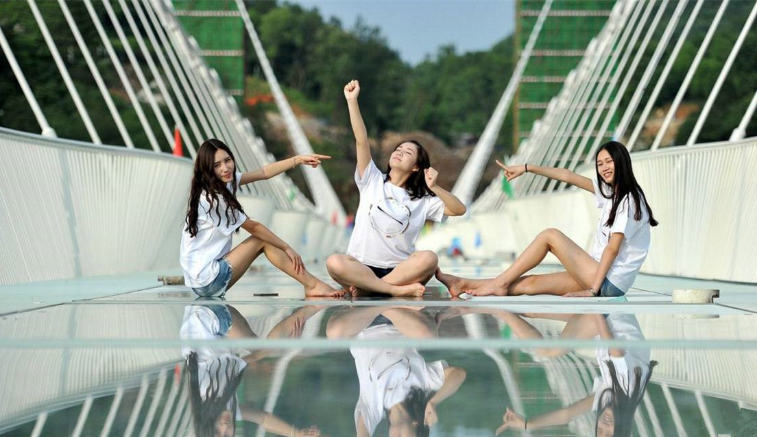 girls sitting on zhangjiajie glass bridge - Zhangjiajie Glass Bridge