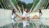 Girls Sitting on Zhangjiajie Glass Bridge
